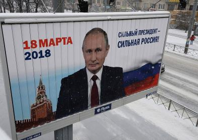 A pre-election banner with the image of the current president of the Russian Federation Vladimir Putin on one of streets of St. Petersburg